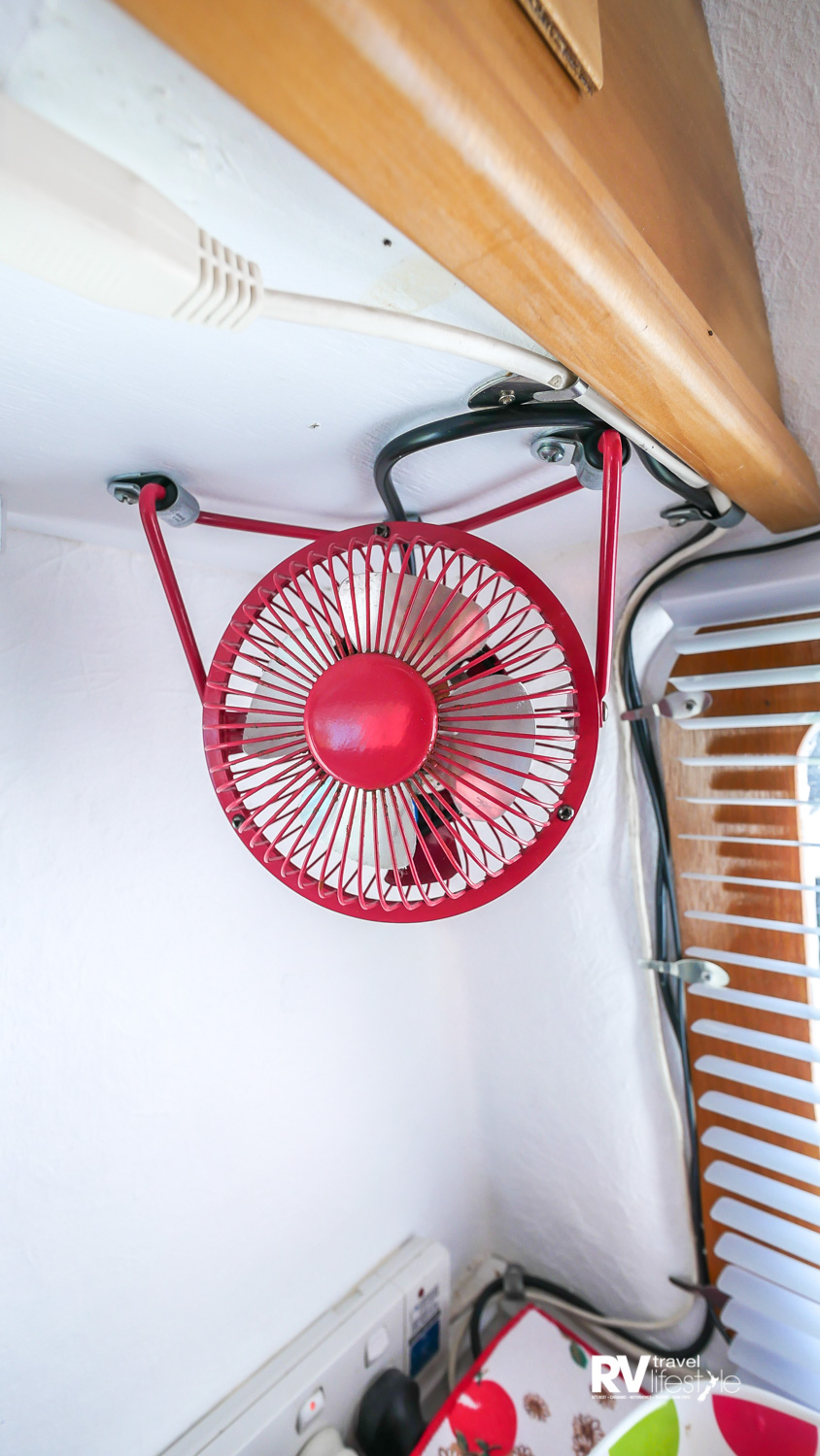 Retro styled and suitably red fan, 1950s air-con unit