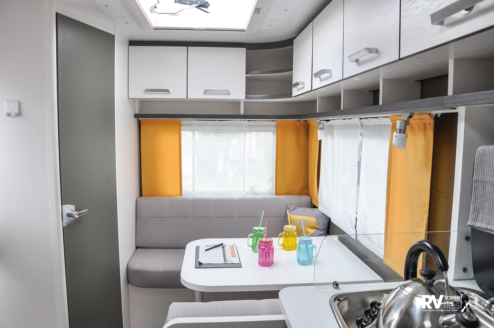 What a little cutie this is, look at all the cupboards and shelving storage. This is a three-berth model so the dining area converts to the third berth