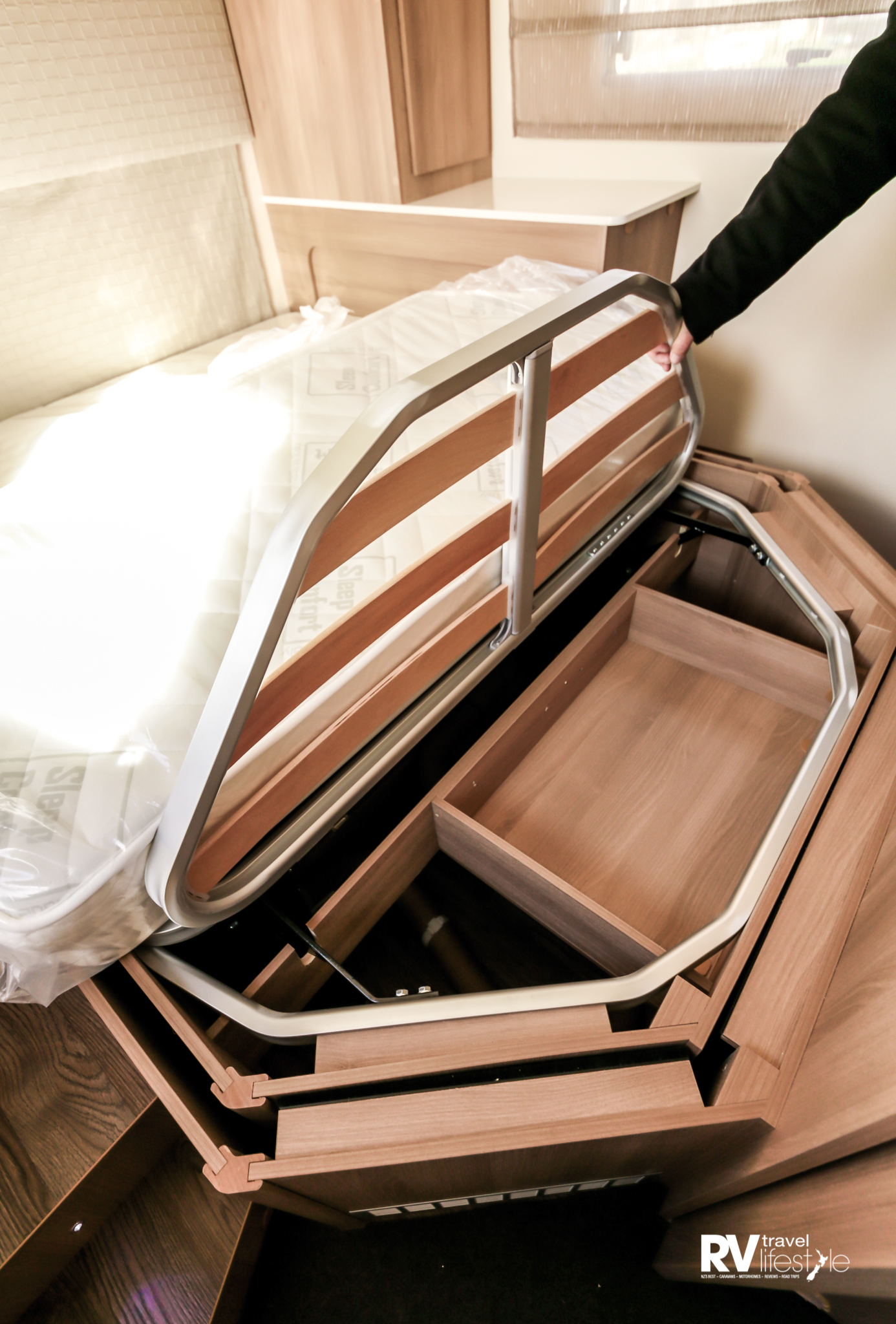 Extra cabin storage under foot of bed