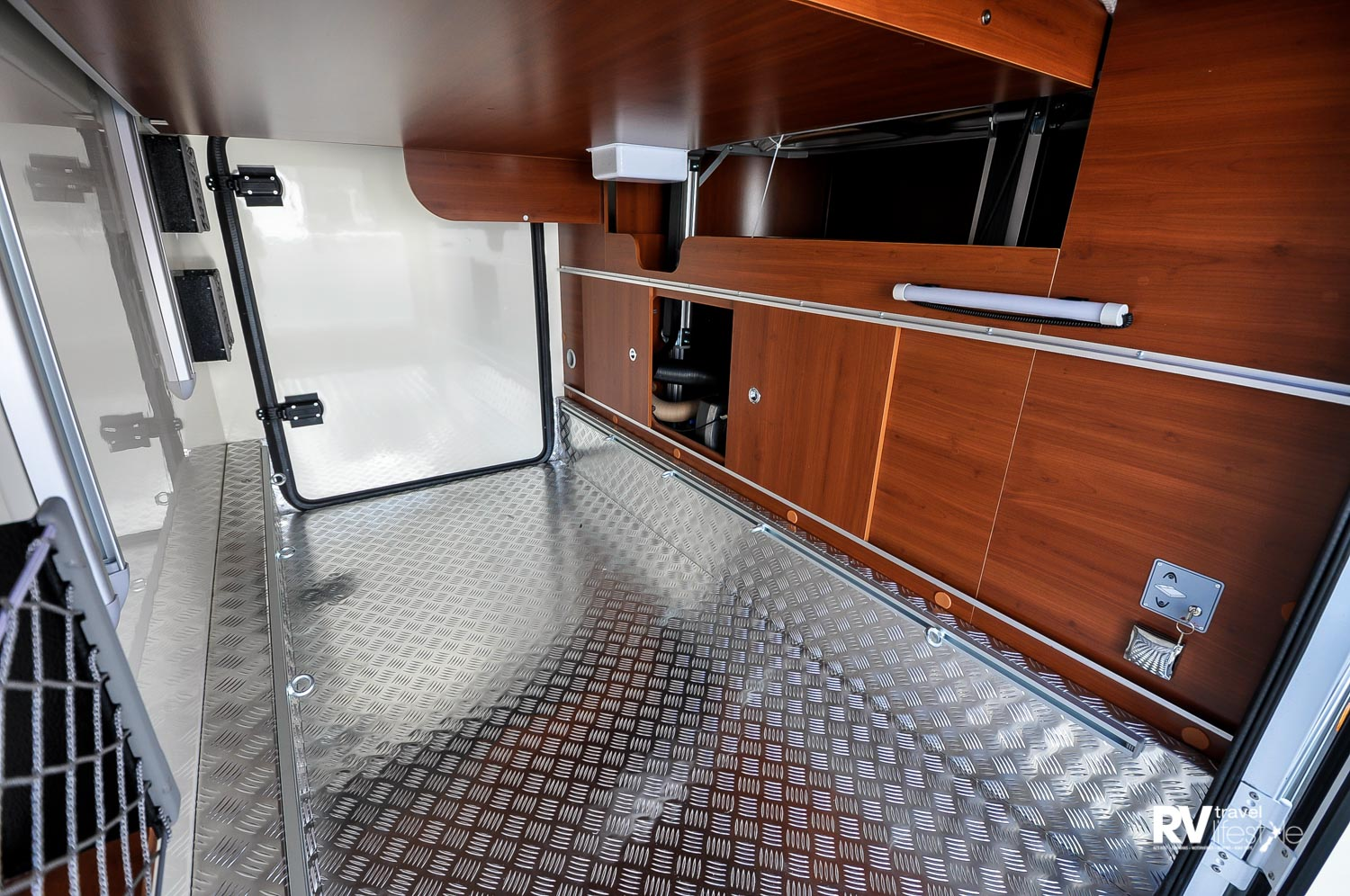 Large rear boot accessible from both sides (the bed lifts up to access storage if required). The floor is level with the door entry, maximum weight 120kg, door height 1100mm, inside garage height is adjustable up to 1470mm
