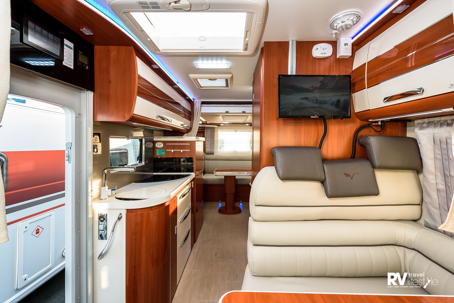From the kitchen looking to the rear bedroom of the K-Yacht 79 model, the vanity, sink unit and mirror take centre stage. This area has a step up, and you may notice the lift-out storage lid in the floor
