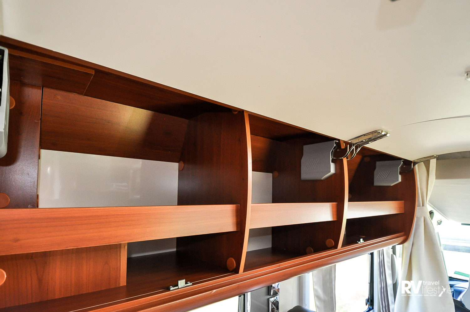 Overhead lockers have shelves with uplifts and quality fittings. Uplifts stop items falling out upon opening – very handy