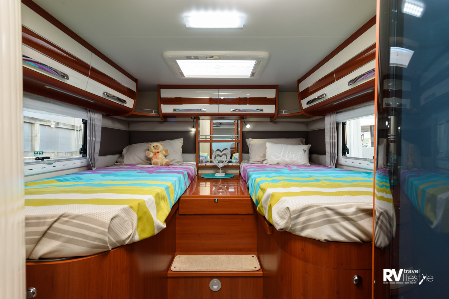 K-Yacht 85 has the two single beds 820x1920mm, and the large exterior locker storage underneath. Plenty of interior storage with overhead lockers, drawers, shelving and wardrobe space