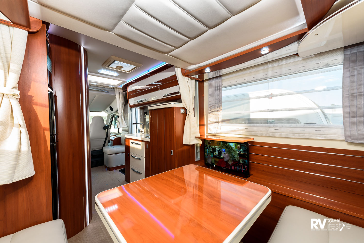 You can see why they call these the K-Yacht series, so beautiful in the styling. Note the RV screen on the right under the window – this glides away to hide out of view. The kitchen is to the left of the entry door