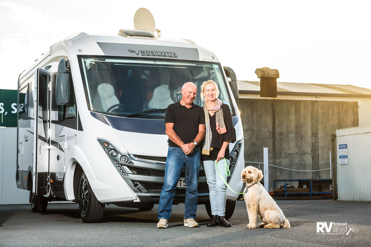 Graeme and Carol Shaw with their dog Alfie, happy and excited to pick up their new Mobilvetta K-Yacht A-Class motorhome from Country RV