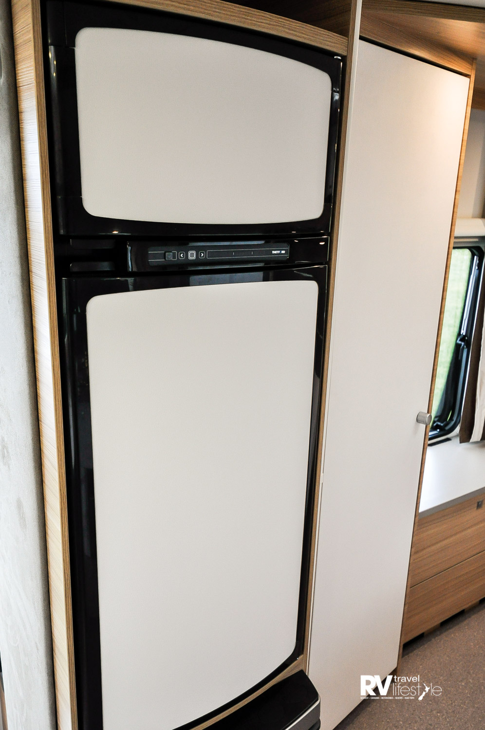 Large 175L three-way auto fridge/freezer unit, with white exterior doors to match the interior finishing
