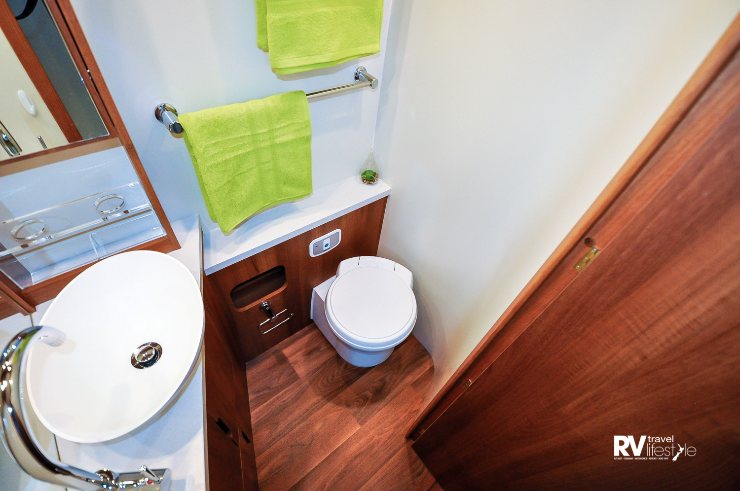 Opposite the shower box is the separate en suite with swivel cassette toilet, vanity unit with quality fittings, plenty of storage options and a large mirror