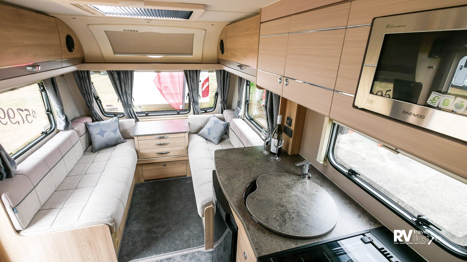 Removeable carpet mats on the floor, under the seating there is plenty of storage, this lounge area also converts to a large second bed 