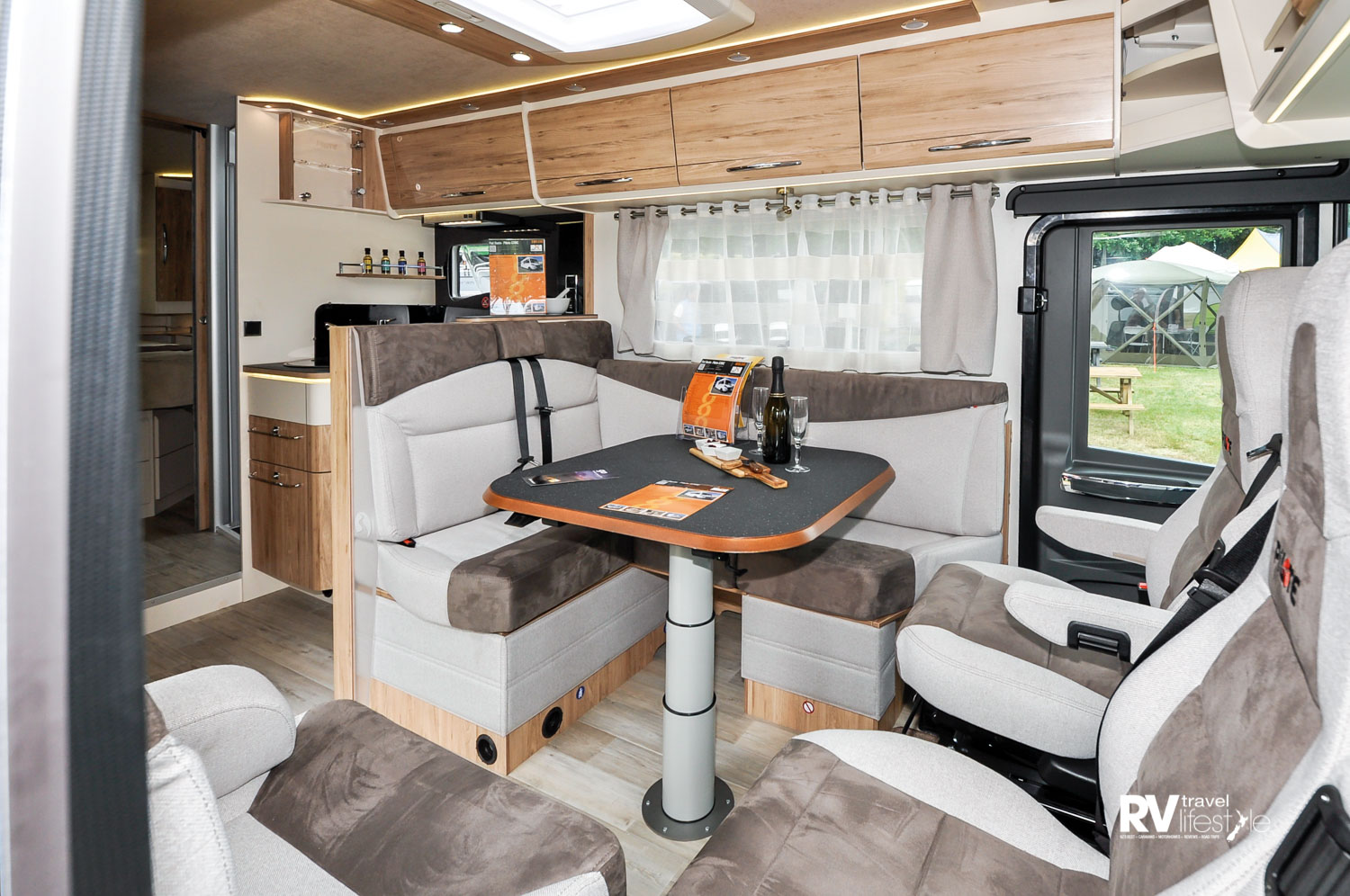 The front cab and dinette view, nice lighting and good-sized seating available, adjustable table height, and this area converts to a bed if required
