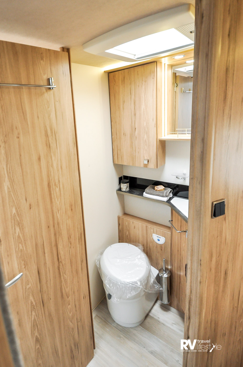 The en suite is well equipped with pedestal swivel electric toilet, plenty of storage, ventilation and lighting
