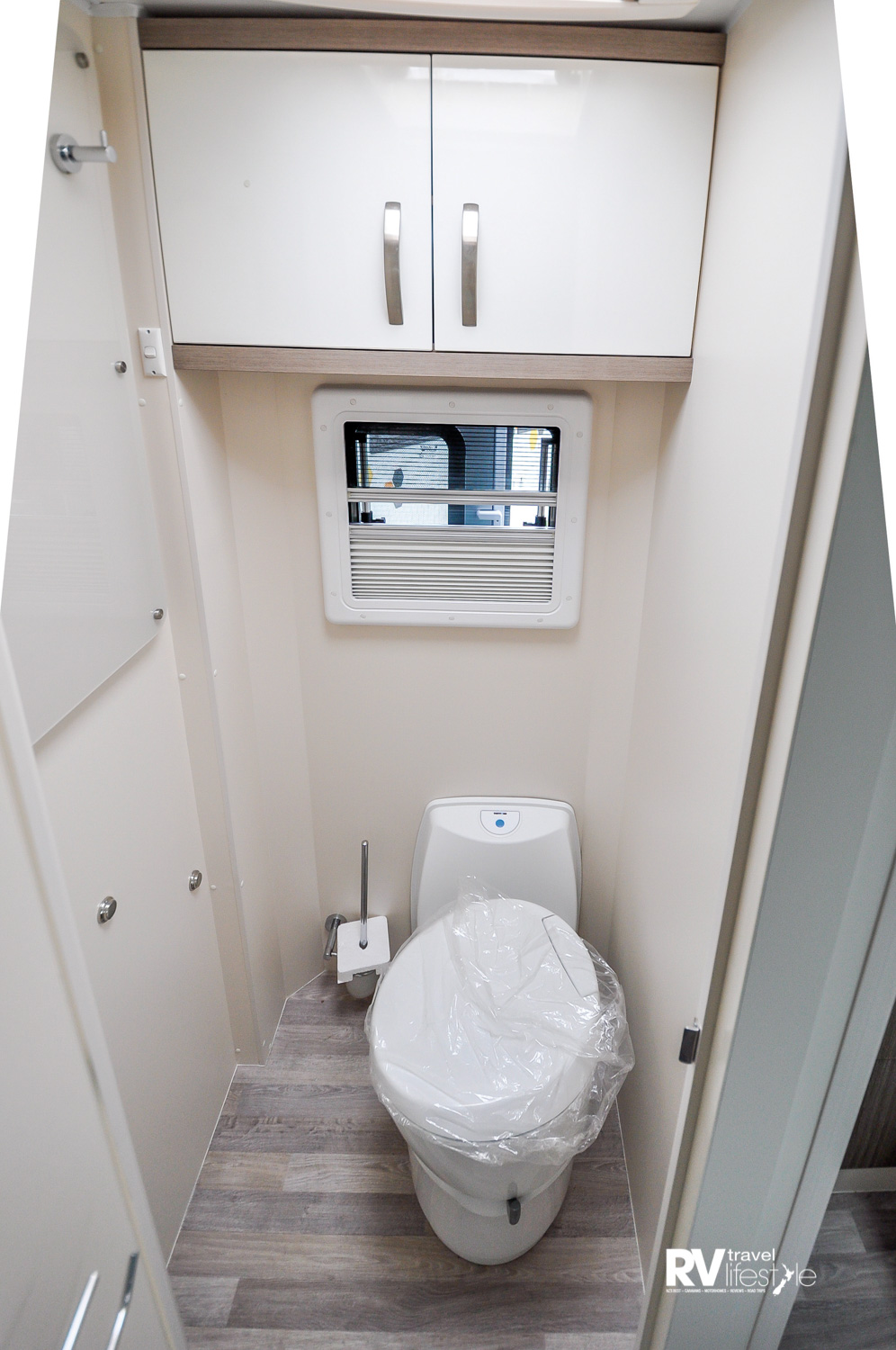The ensuite toilet area is a great size, with a window and a vent for light and airflow – plenty of storage options in here as well