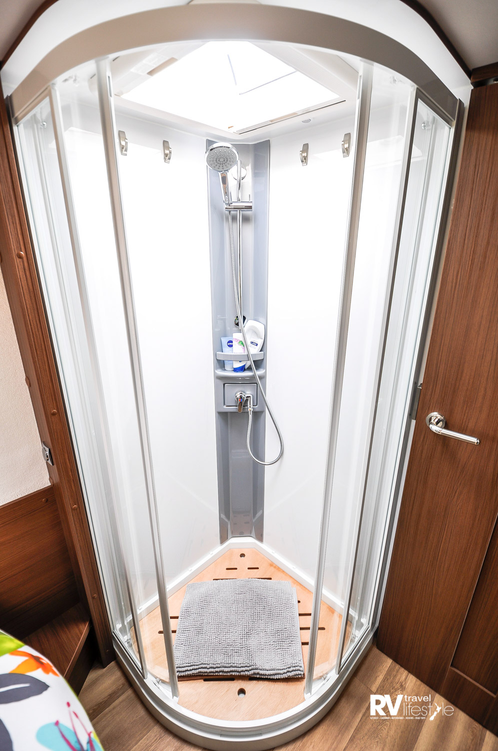 The large shower comes with a wooden floor