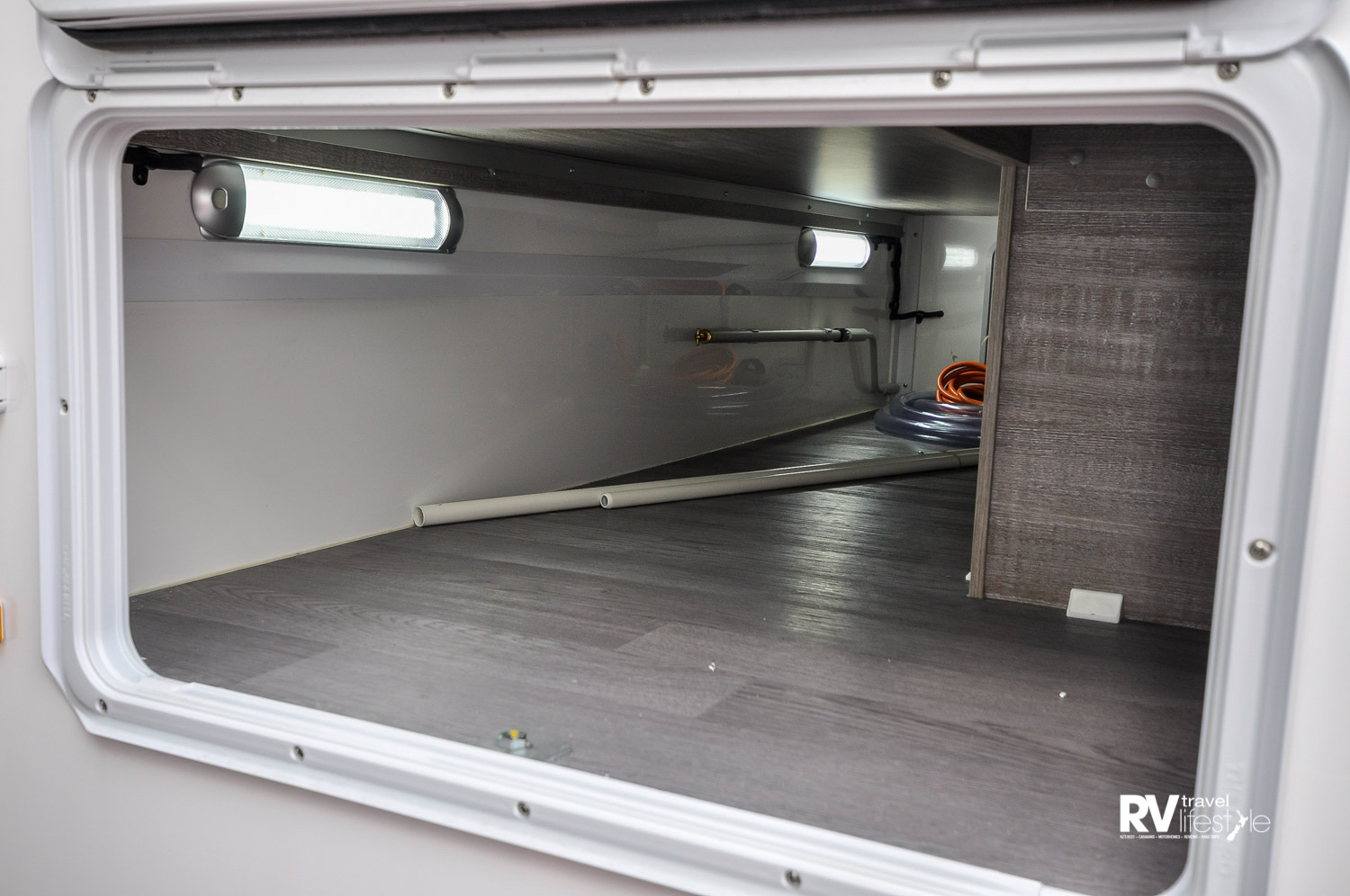 Accessed from both sides, this rear storage area is well lit, and a good size