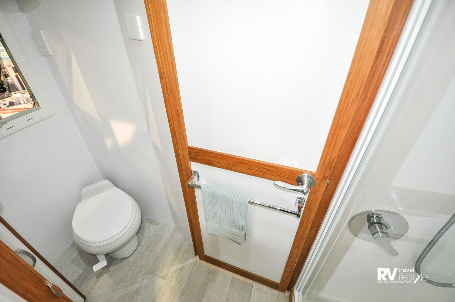 The toilet en suite is opposite the full shower, in this photo the privacy door is shut to the living area, so much room, so light, right and modern in finish