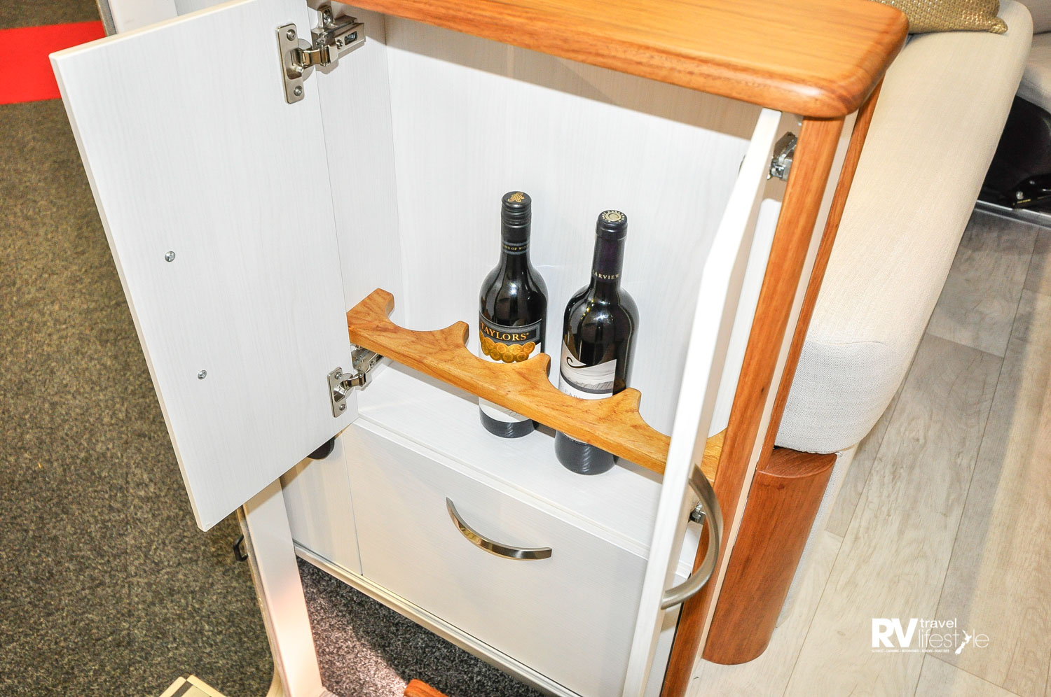 A very useful cupboard tucked to the left side upon entry to the vehicle, provides safe wine bottle storage, I like it