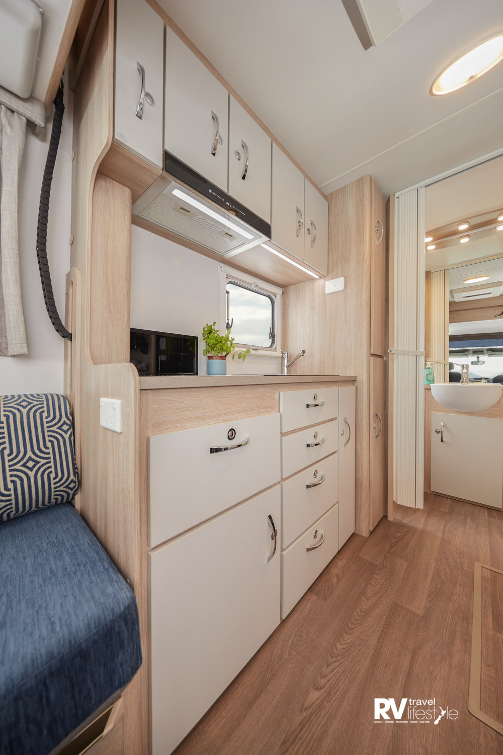 Interior floor space is good, the kitchen offers multiple under-bench drawers and cupboards, as well as overhead cupboards for storage. The bathroom area is mid-ship with bedroom behind in the rear
