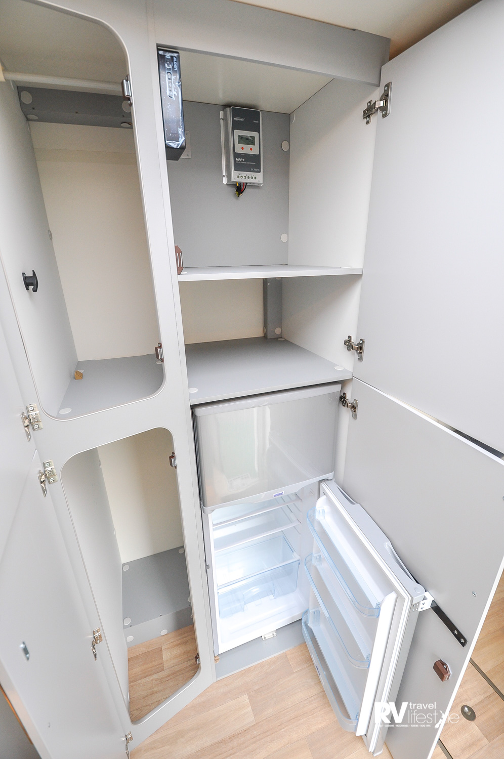 Storage anyone? Seriously check out these two wardrobes, and even more cupboard storage next door. The fridge/freezer is a 169L compressor unit and has a gloss cover door to match the exterior lines beautifully