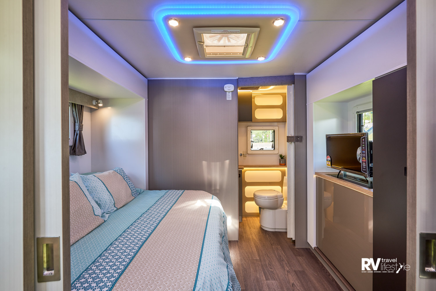The bed in the twin slide-out bedroom shown in day mode