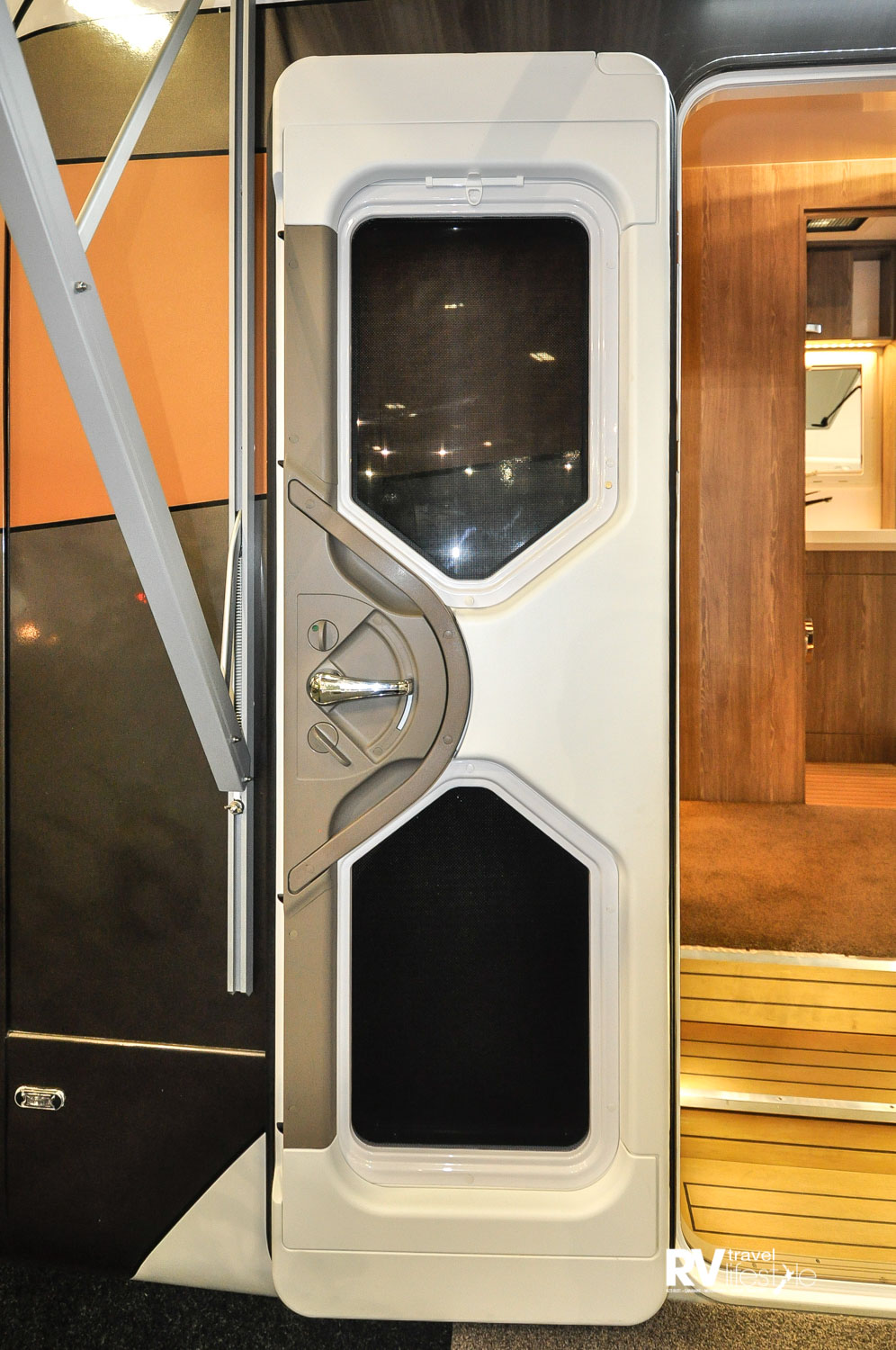 The habitation entry door has viewing ports, but also a privacy blind and built-in fly screen.