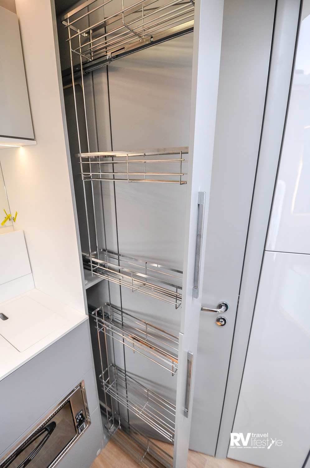 Check out this full height pull-out pantry unit, very sleek. The bathroom door shows behind it