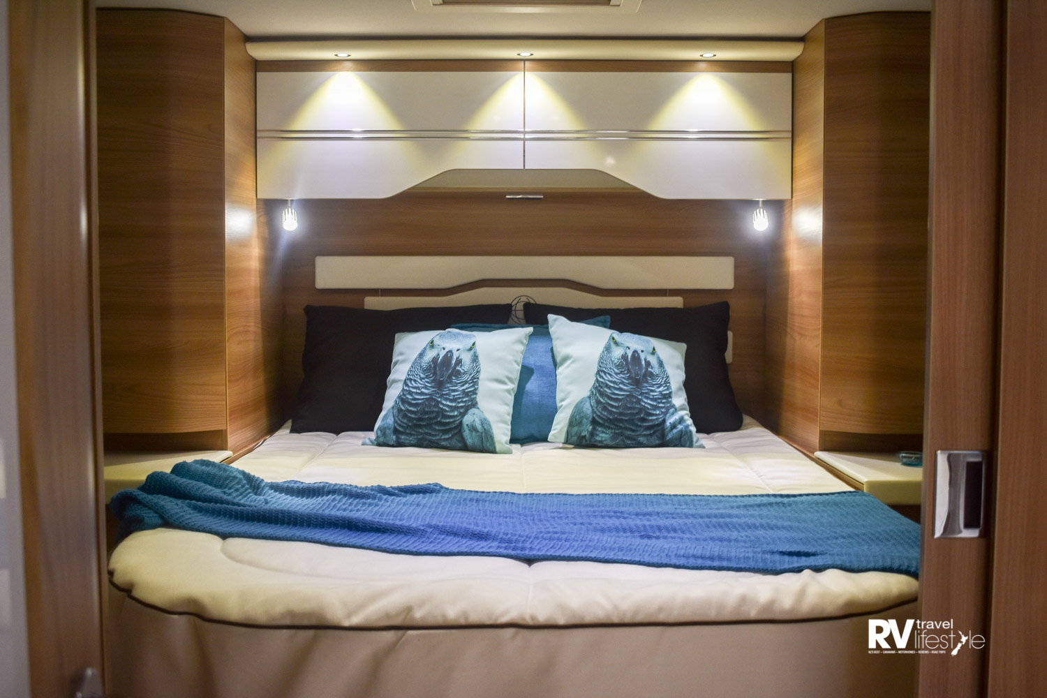 The lighting and underneath storage are features of the bedroom suite