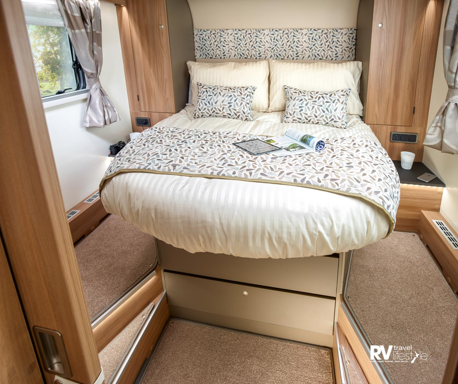 Bailey Autograph 79-4 model has the rear bedroom with island bed, drawer storage underneath, steps each side, central heating vents, power poiints, wardrobes on each side and a nice bedhead finish