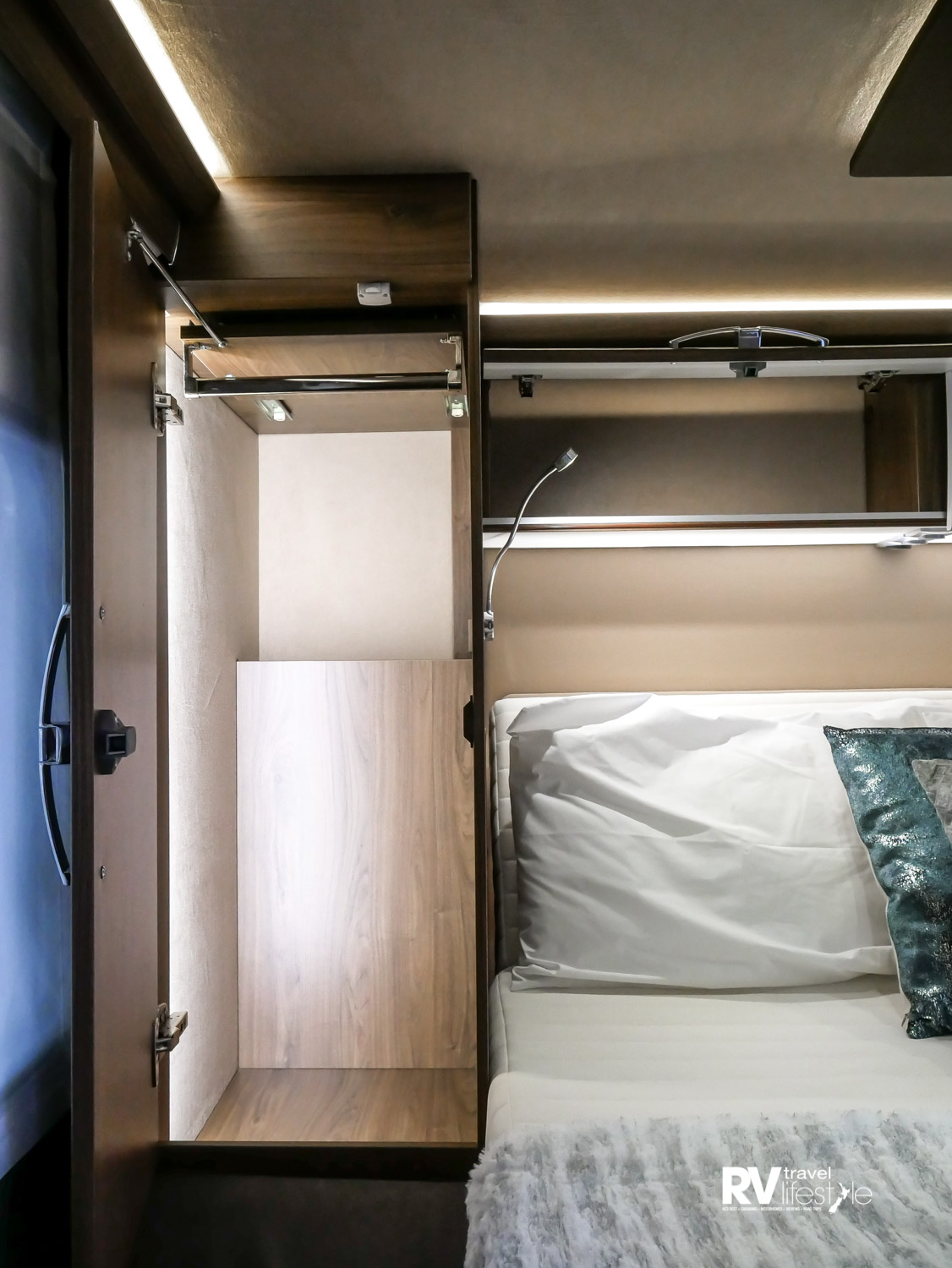 Wardrobes have lighting within; plenty of length, width and depth in this space