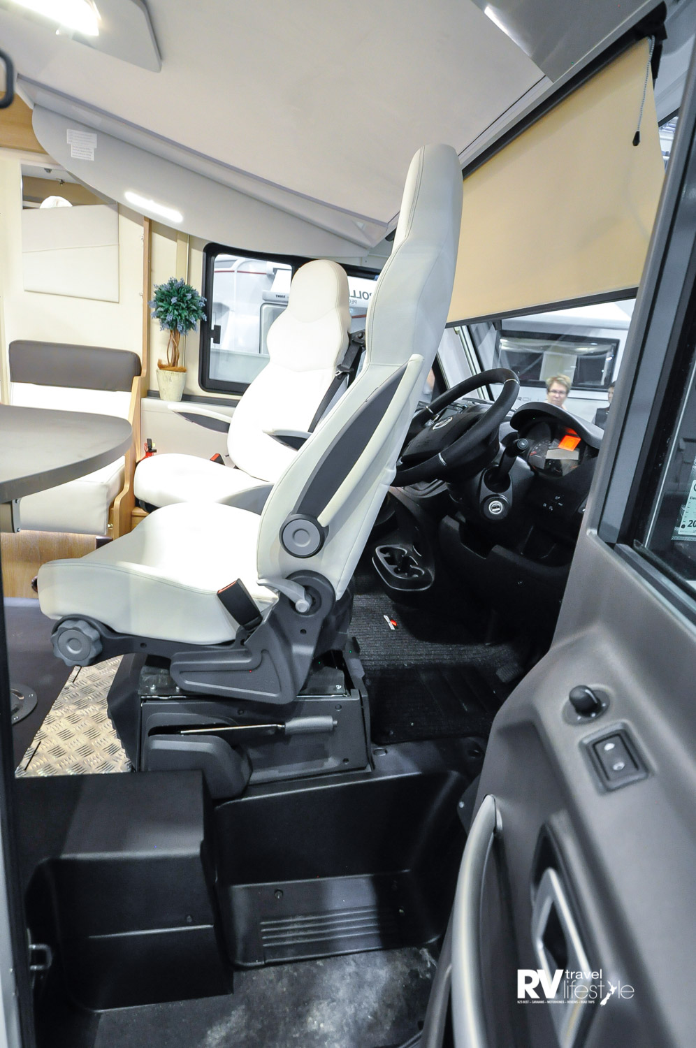 The front cab entry is easy with large entry doors, and the swivel of the Captain chairs doubles as a living area extension. Ceiling bed above very discrete. Front cab blinds close the area off for privacy