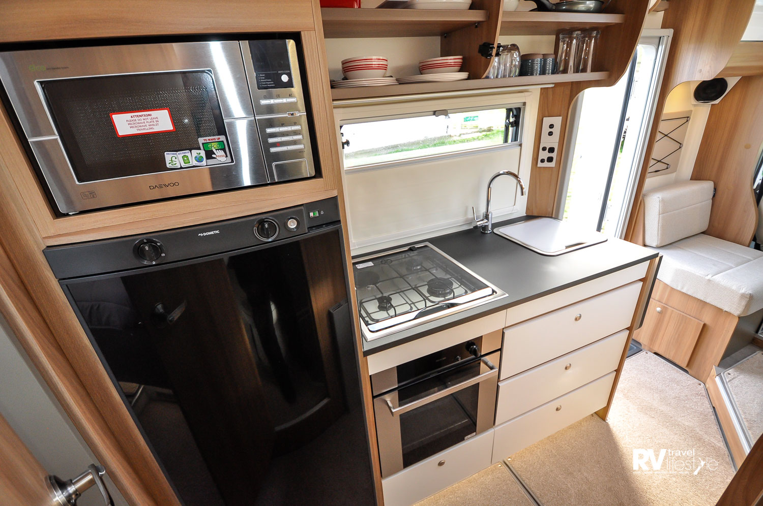 The kitchen is well fitted with a stainless steel 800 watt microwave, a Dometic 145L fridge with removeable internal freezer unit. The Thetford dual-fuel hob with electric hotplate and three gas hobs will work for all.