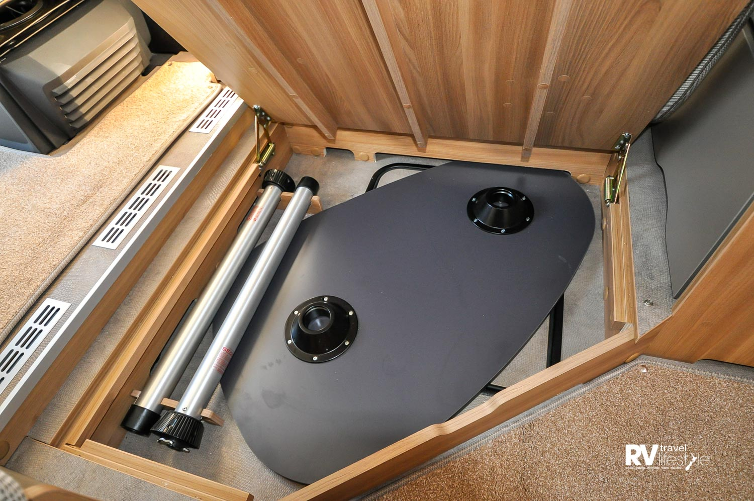 The dining table and legs are stored in the floor itself, and a second hatch under that gives access for maintenance as required to fixtures fitted in the sub floor