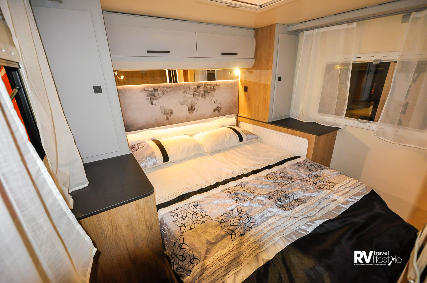 Rear bedroom with island bed, which adjusts in height to offer less or more boot space. Light and bright roomy