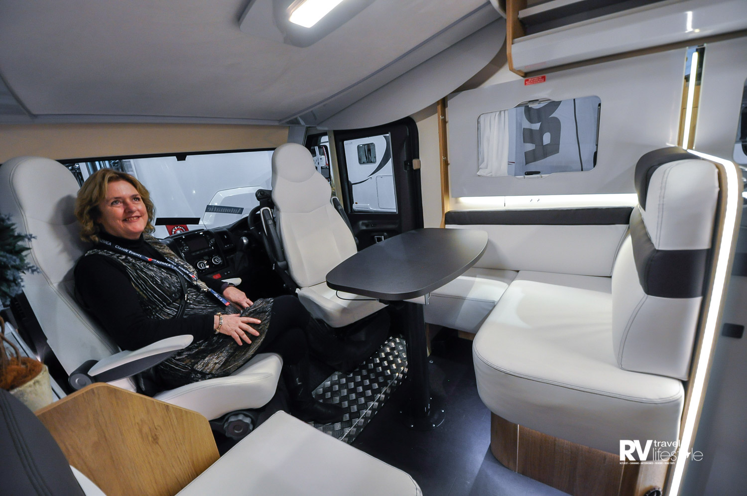 Comfy swivel cab seats add to the seating format in the entertainment area – note the ceiling bed above, very discrete