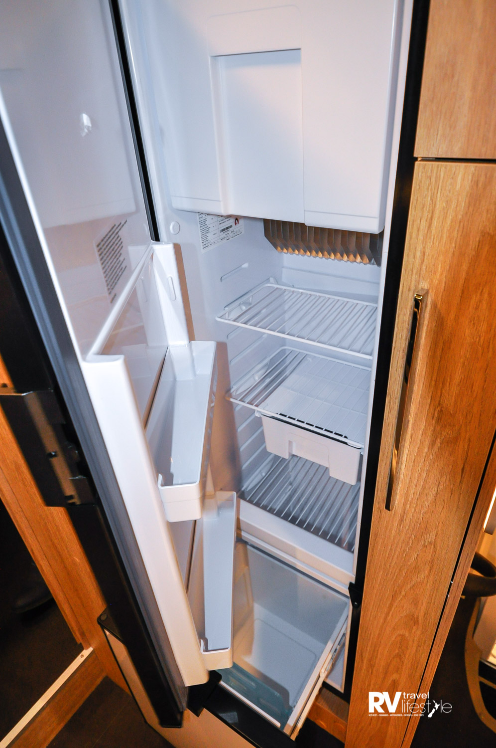 This is a 140L three-way auto Trivalent fridge with interior freezer box, and look below – there is a separate chiller drawer beneath – what a great design