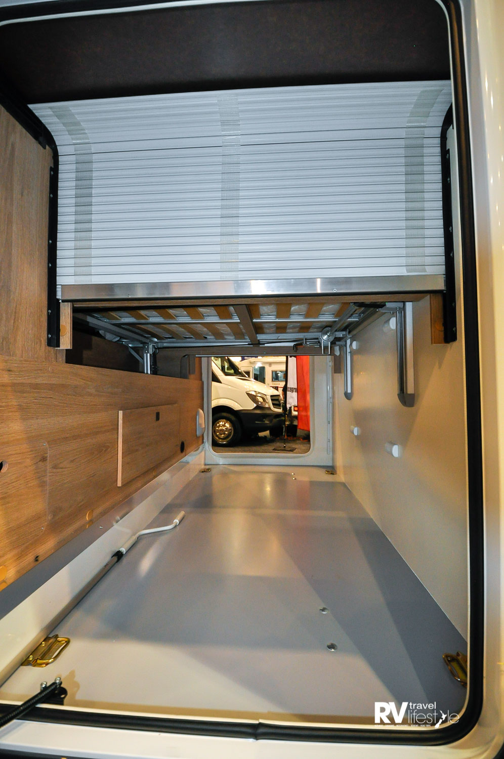 Large exterior rear boot storage, adjustable by lowering or raising the bed above. You can fit large items and secure them in here