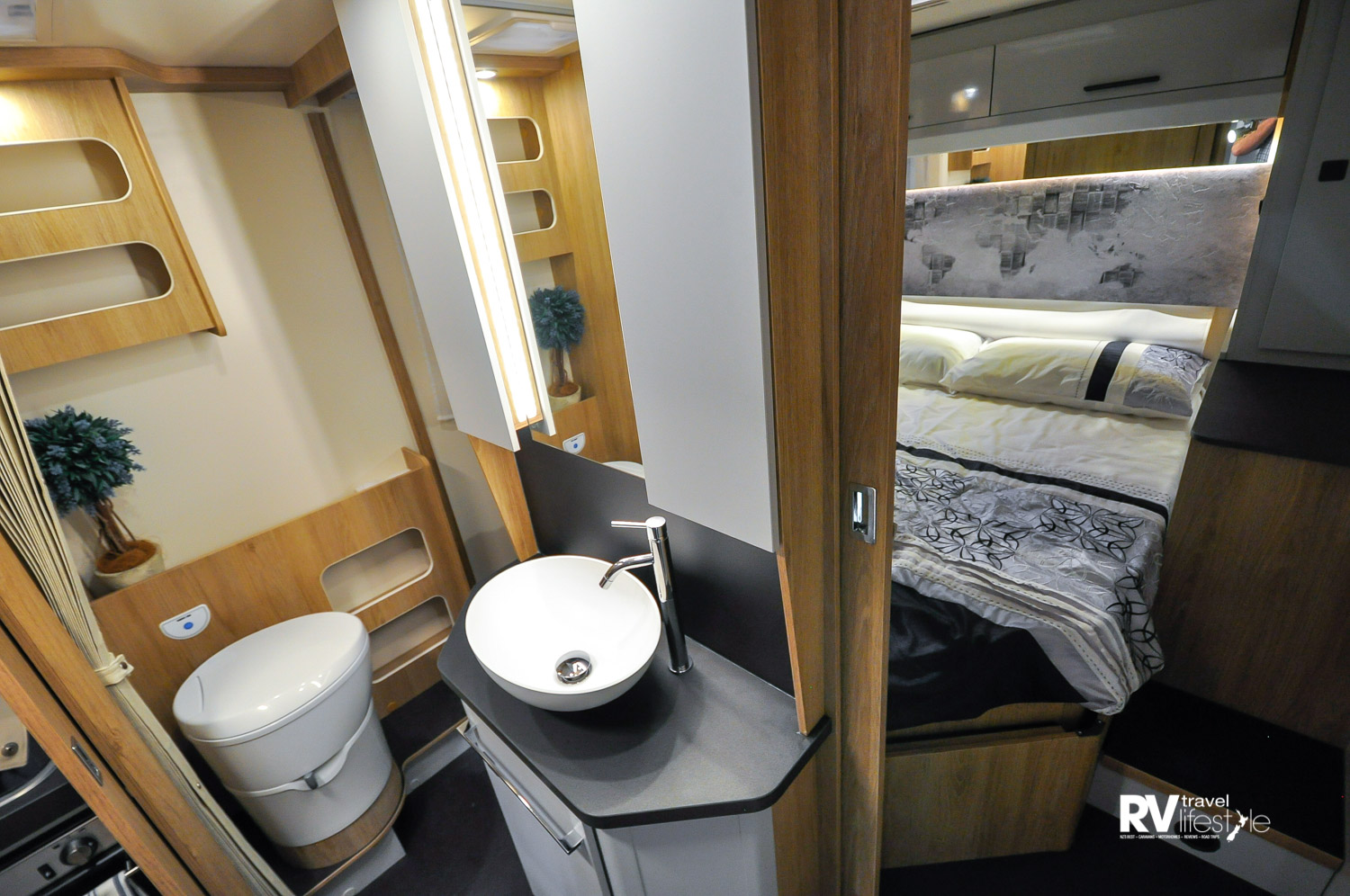 The en-suite bathroom with electric-flush swivel toilet, lots of storage spaces available, well lit, and mirrors add to the spacious feel