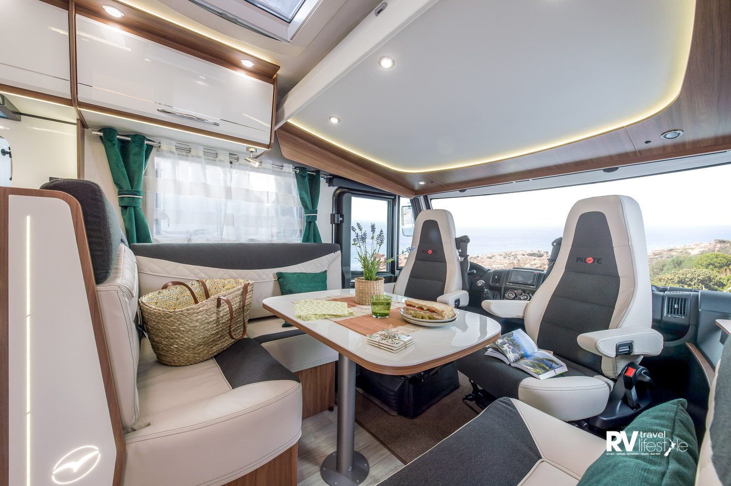 A spacious lounge/dining area - second berth comes down from the cab ceiling, light interior finishes