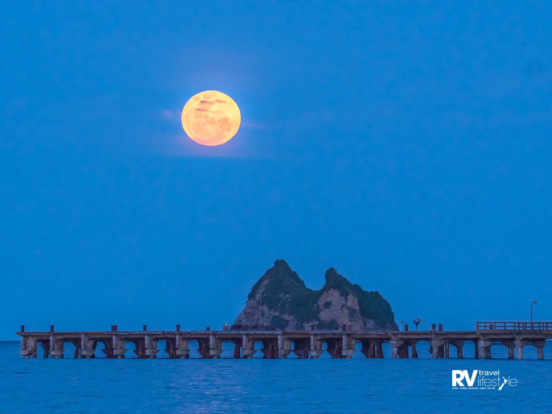 Tolaga Bay wharf under a full moon. Photo by Damon Meade