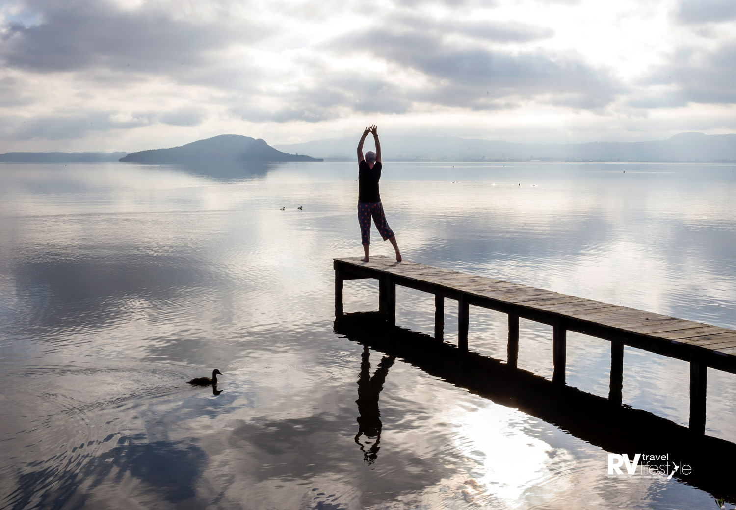 Clare embraces the morning at Lake Rotorua