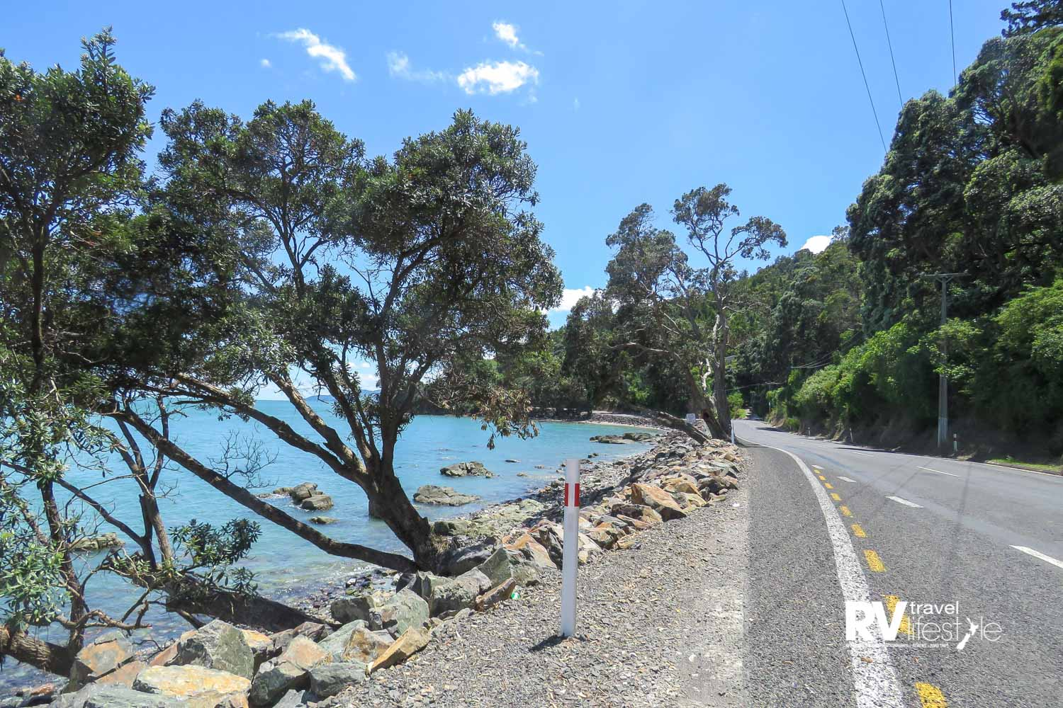 The road up the west coast of the Coromandel Peninsula is right on the seashore