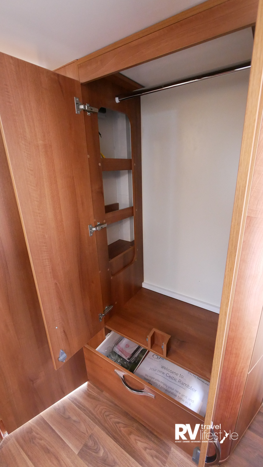 So much storage in this full-height wardrobe, as well as a drawer under the bed and the cupboards behind the bed head