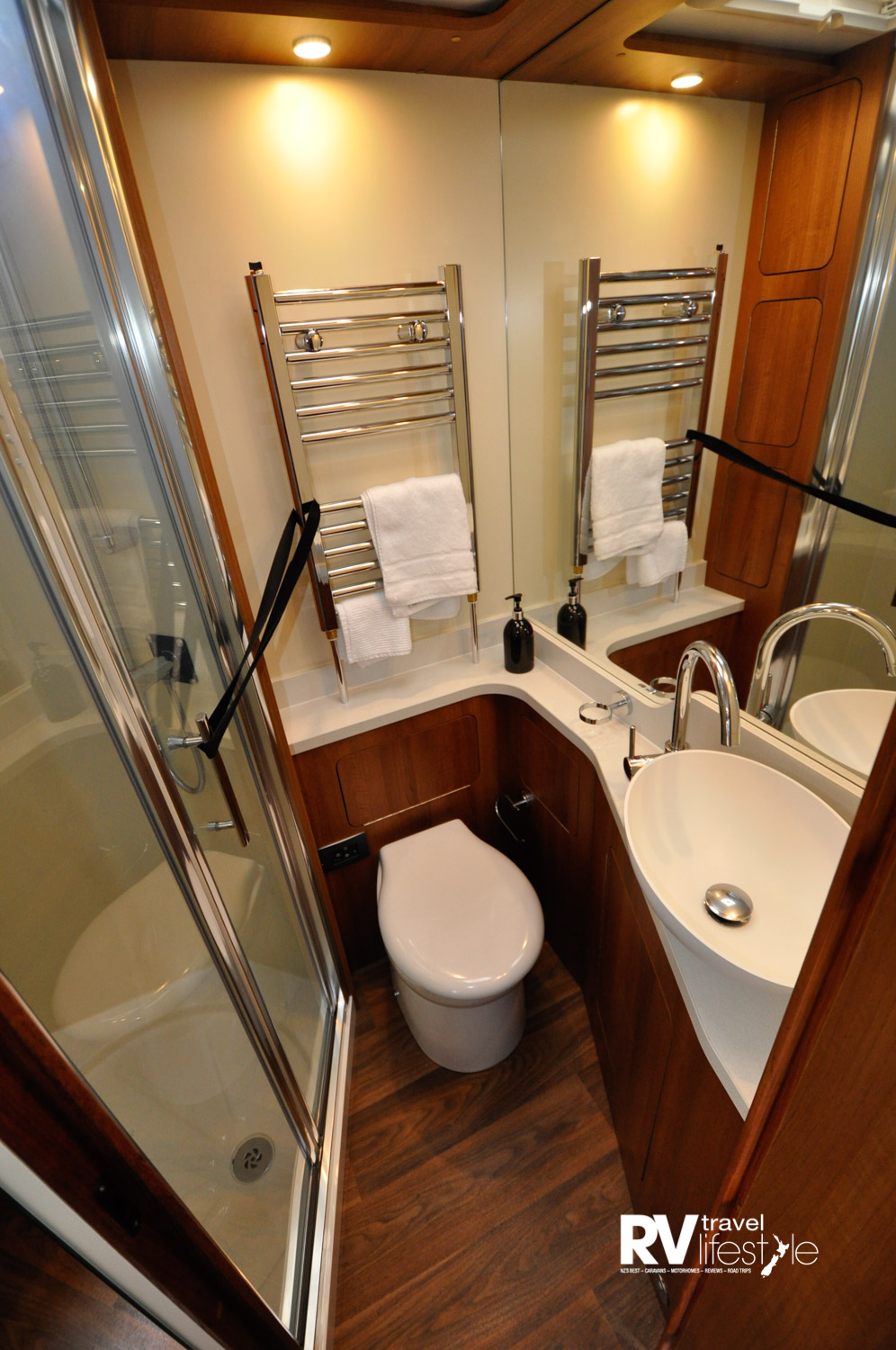 The bathroom and kitchen both have nonslip waterproof flooring. The internal height is 2200mm, giving a feeling of spaciousness you don't often get in an RV and the slide-out adds 2.7m2 extra floor space