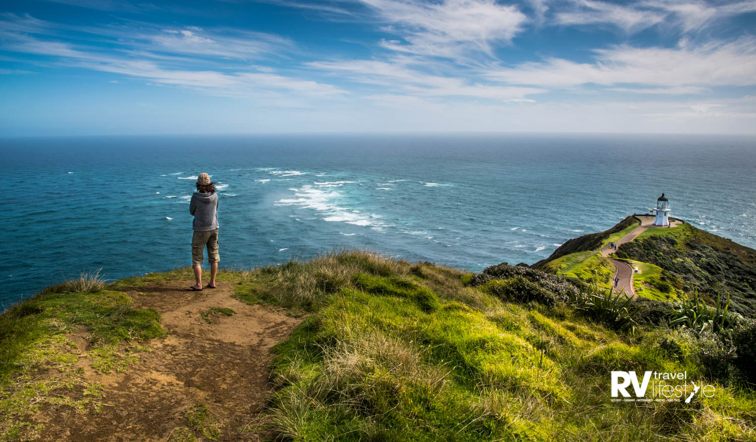 Justine awed by the meeting of two mighty oceans at Cape Reinga, Far North