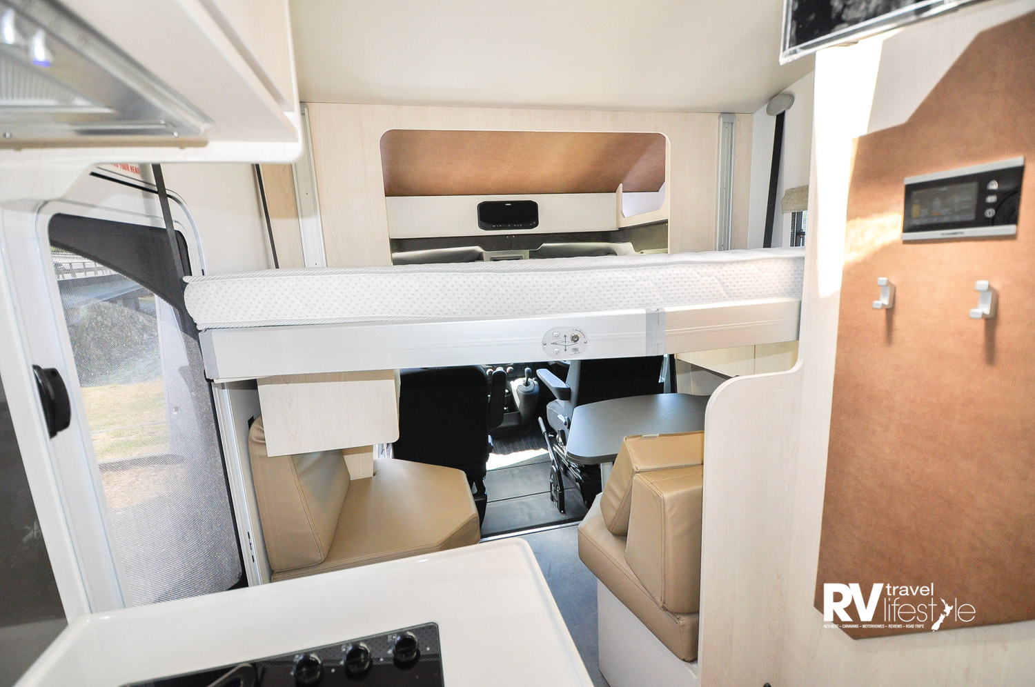 This model has two electric ceiling beds aimed at making the most of the floor space for living, this is over the dinette area behind the cab