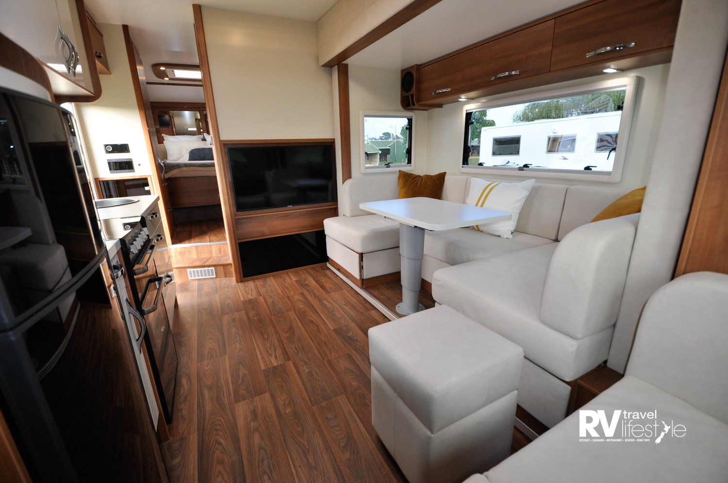 The flooring looks and feels like real wood (vinyl) and has underfloor heating. The internal height is 2200mm, giving a feeling of spaciousness you don't often get in an RV and the slide-out adds 2.7m2 extra floor space