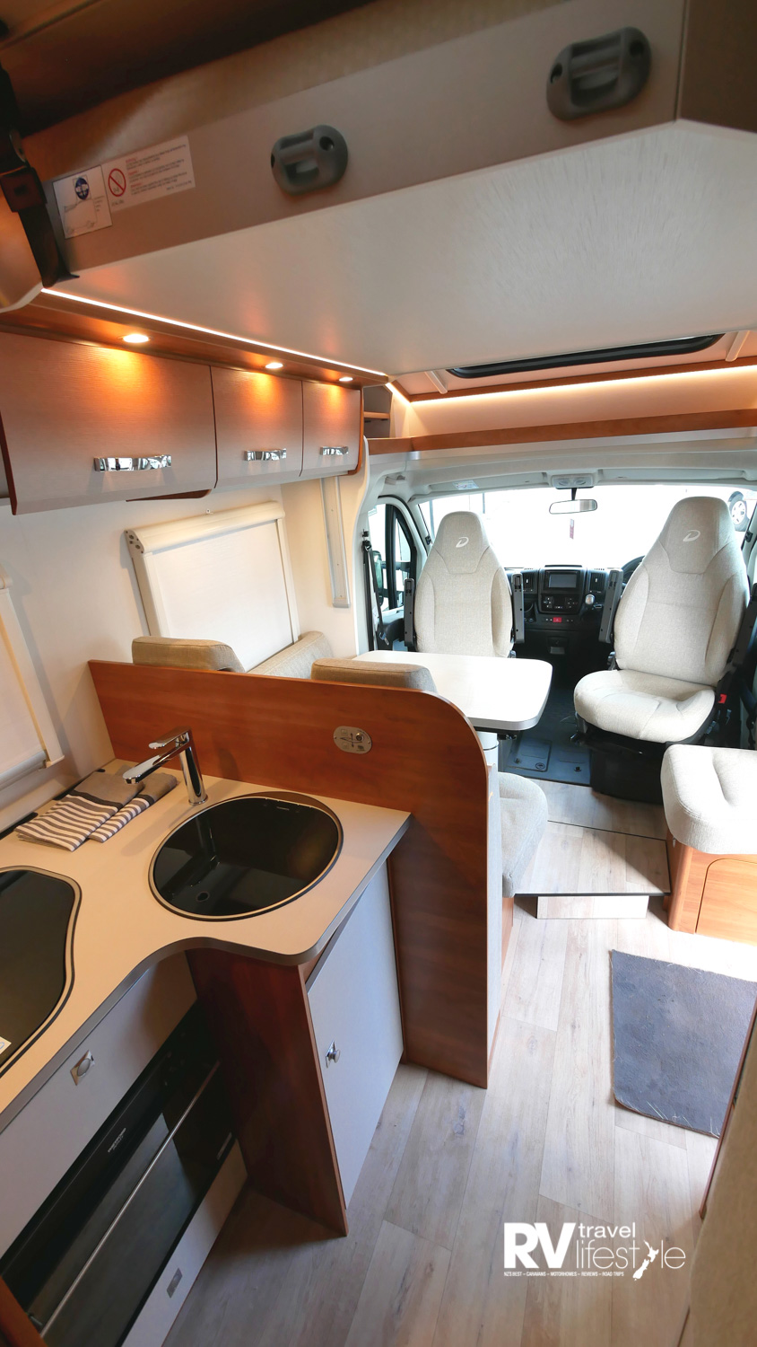 Upon entry the step-up dinette to the right with swivel cab seats. To the left is the kitchen area
