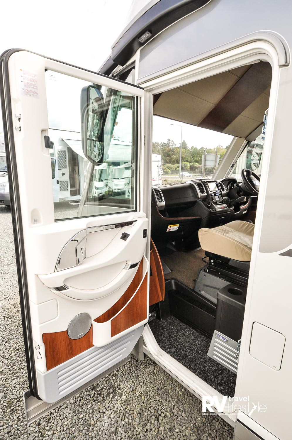 Passenger entry door: what a good-looking door, fitted window privacy blinds, storage and easy step up into the expansive cab area