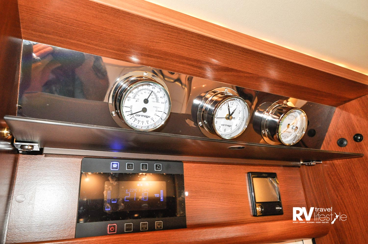 A nautical theme to the large easy-read dials, monitors and controls all in one area above the entry door