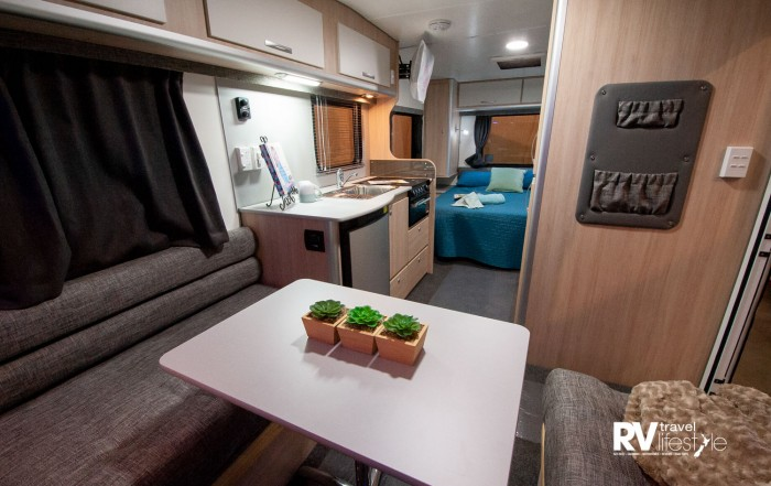 The lounge area can be made up into a large second bed. Heating vents are well placed, quality foam squabs and fabrics make for a comfortable seating area, colours can be chosen by clients to personalise your caravan