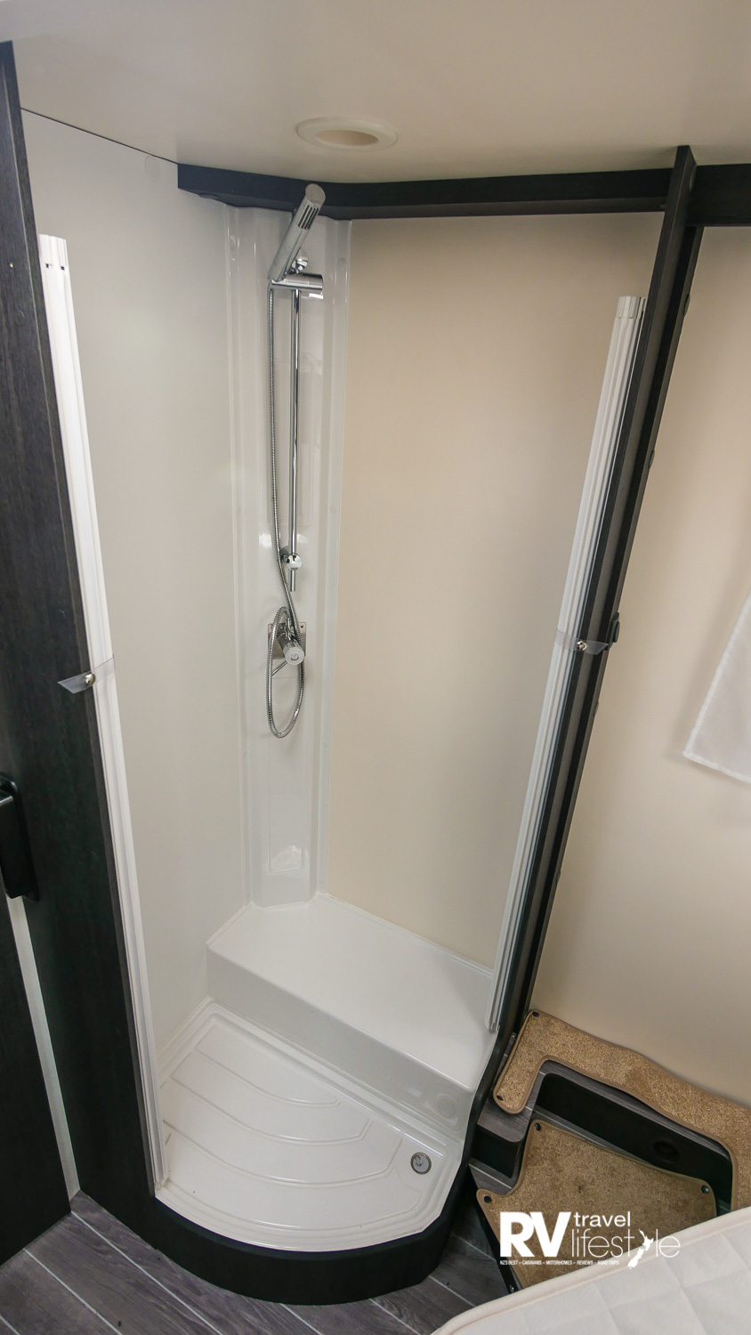Full-height shower on the left wall at entry to bedroom