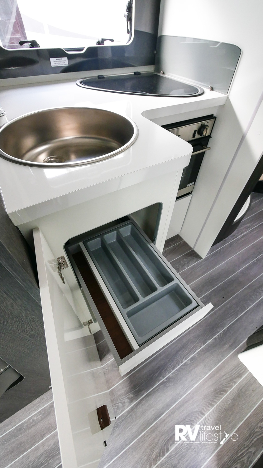 Storage and utility drawer under the sink unit